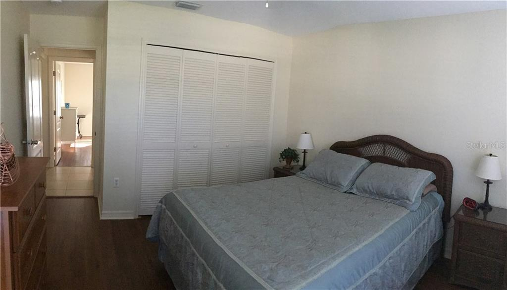 Guest Bedroom and view into Guest Hall - Single Family Home for sale at 6320 Hera St, Englewood, FL 34224 - MLS Number is A4200968