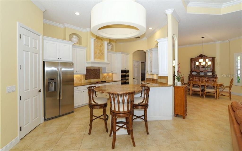 Gourmet Kitchen with circular shaped bar - Single Family Home for sale at 1746 Hillview St, Sarasota, FL 34239 - MLS Number is A4202985