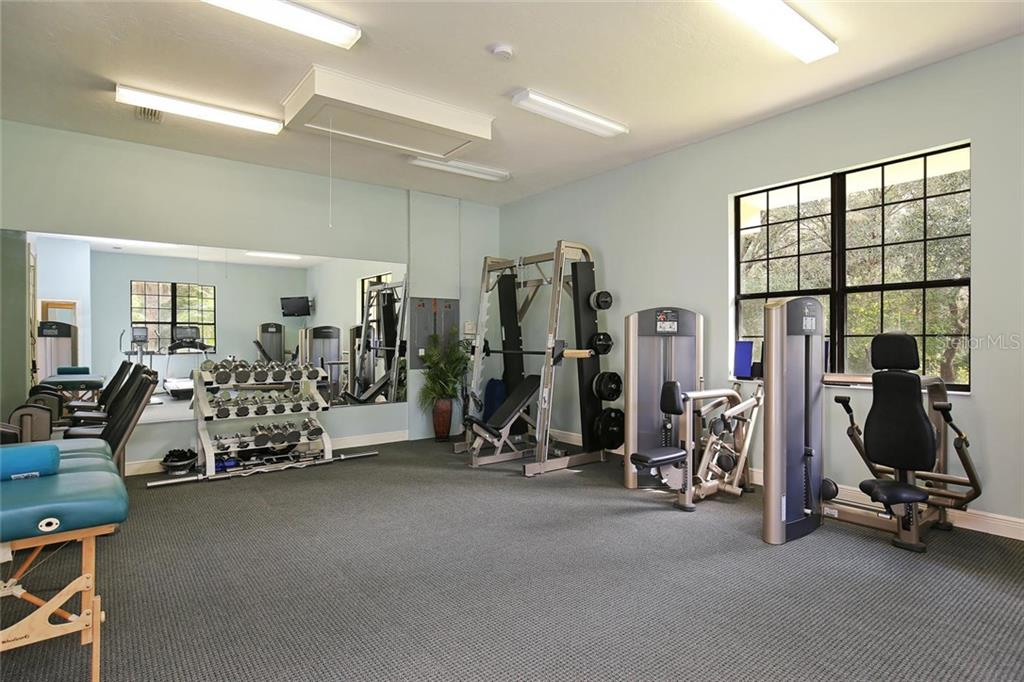Gym with powder bath - Single Family Home for sale at 7300 Chameleon Way, Sarasota, FL 34241 - MLS Number is A4203429