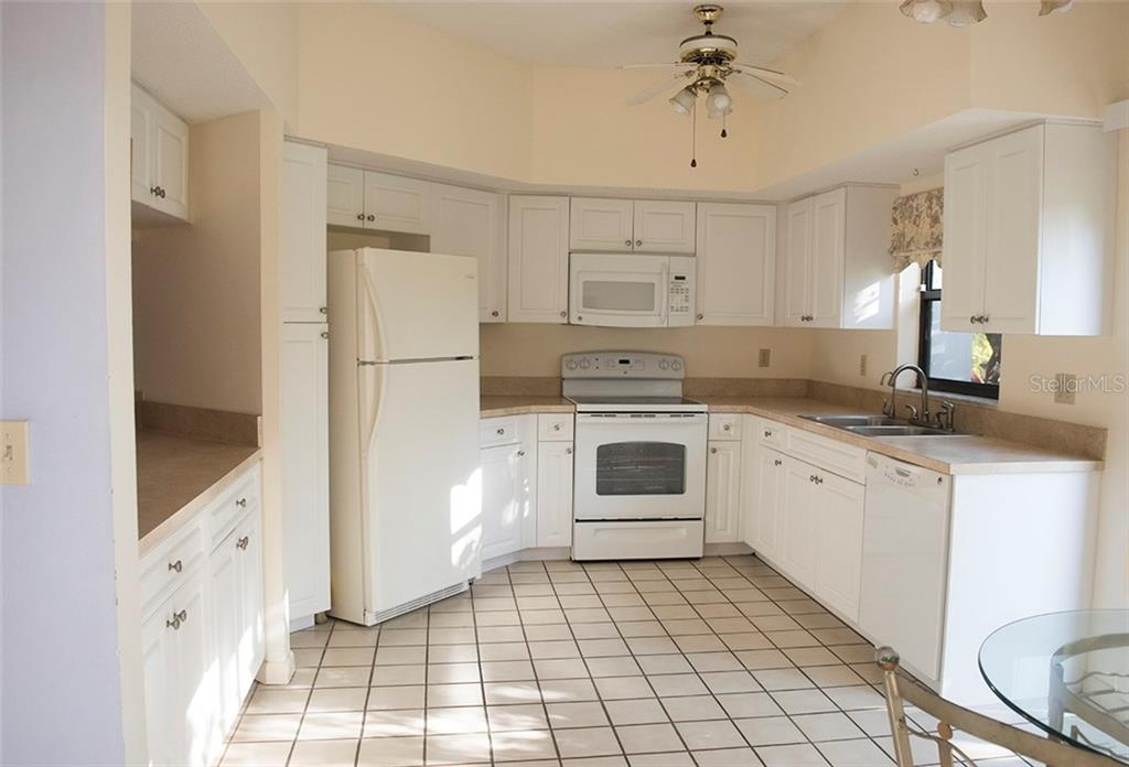 Spacious Kitchen with lots of counter space and cabinetry. - Condo for sale at 1618 Starling Dr #105, Sarasota, FL 34231 - MLS Number is A4204864