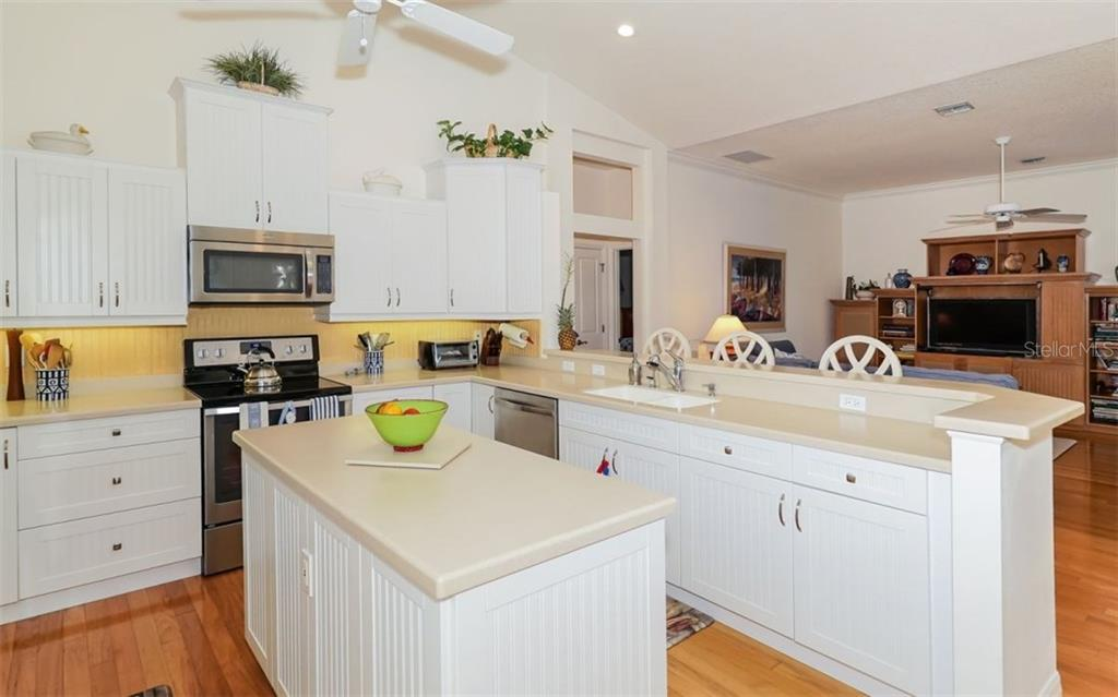 Kitchen with Large Island - Single Family Home for sale at 460 Otter Creek Dr, Venice, FL 34292 - MLS Number is A4205372