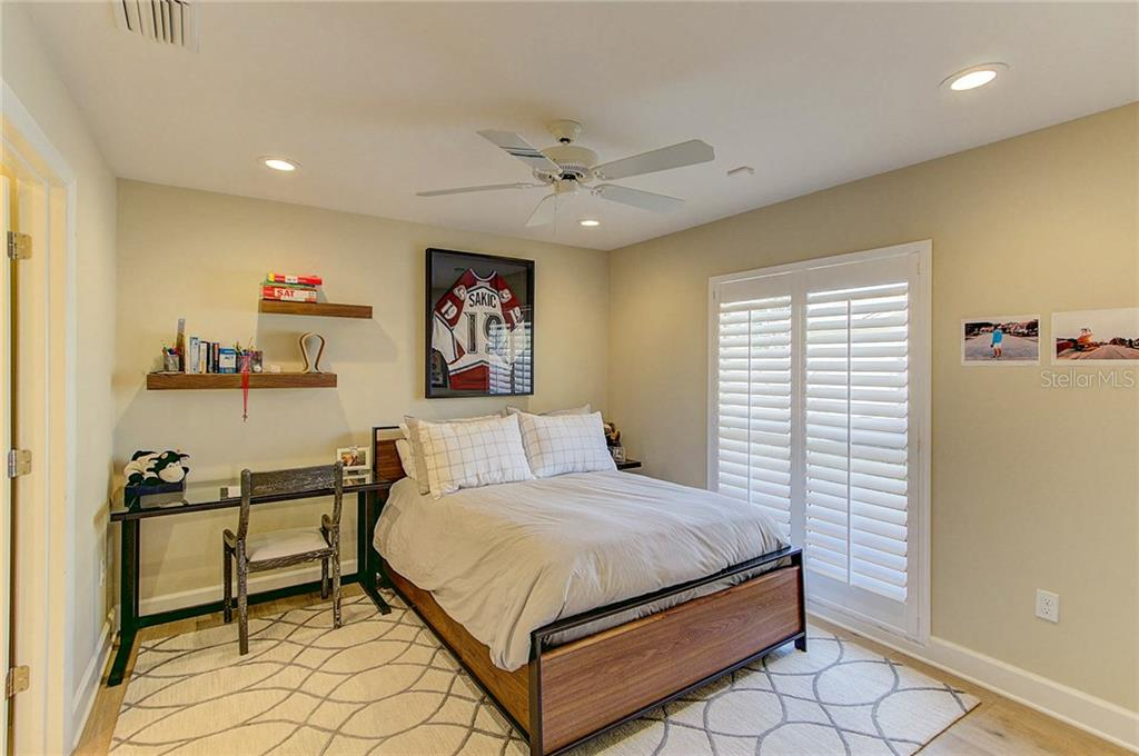 Bedroom 3 is en-suite, recessed lighting and plantation shutters. Custom build closets will help keep you organized. - Single Family Home for sale at 3508 Avenida Madera, Bradenton, FL 34210 - MLS Number is A4205393