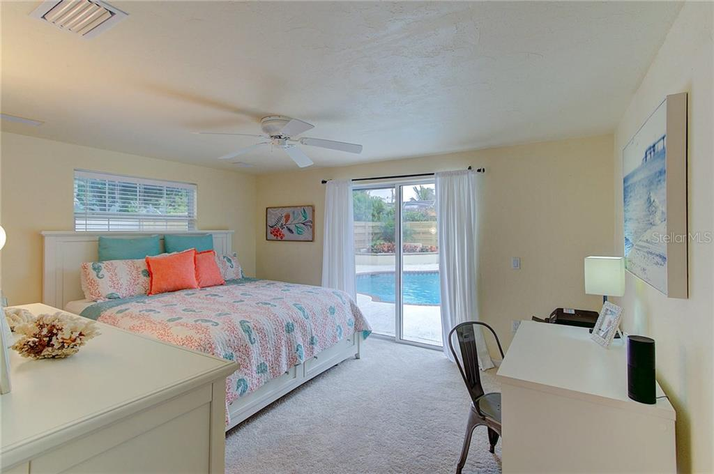 Wake up to the island breezes and step outside and enjoy your morning coffee poolside! The master bedroom also has two closets. - Single Family Home for sale at 501 70th St, Holmes Beach, FL 34217 - MLS Number is A4205799