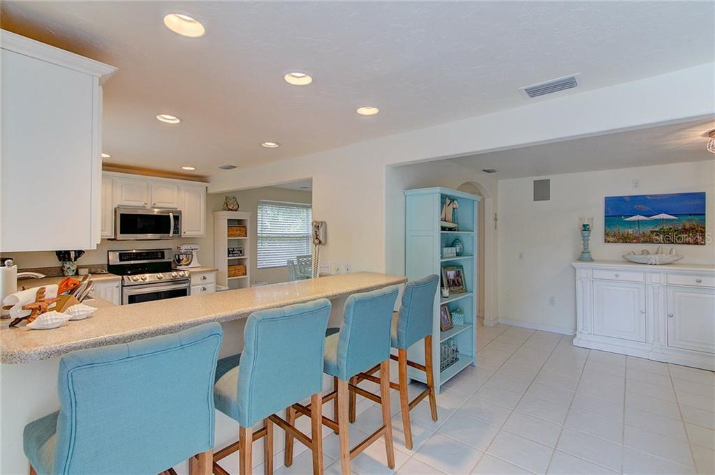 Seating for four at the breakfast bar. - Single Family Home for sale at 501 70th St, Holmes Beach, FL 34217 - MLS Number is A4205799