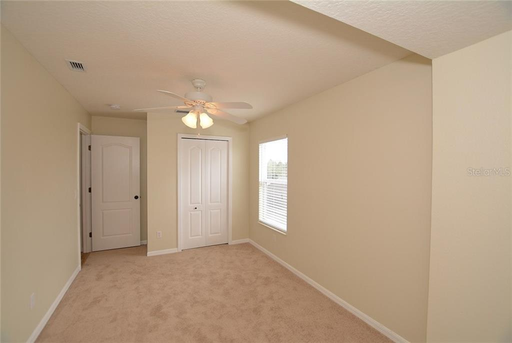 Bedroom 2 - Single Family Home for sale at 6320 Robin Cv, Lakewood Ranch, FL 34202 - MLS Number is A4205857