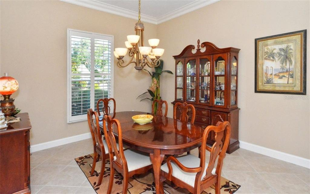Dining room - Single Family Home for sale at 3882 Spyglass Hill Rd, Sarasota, FL 34238 - MLS Number is A4206477