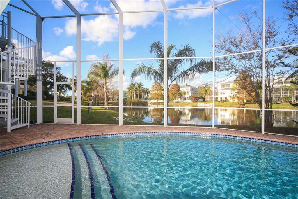 Oversized first pool step to cool off - Single Family Home for sale at 7047 Hawks Harbor Cir, Bradenton, FL 34207 - MLS Number is A4206626