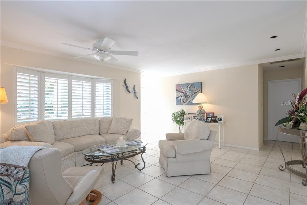 Living room, looking to the entry. - Single Family Home for sale at 5633 Cape Leyte Dr, Sarasota, FL 34242 - MLS Number is A4207008