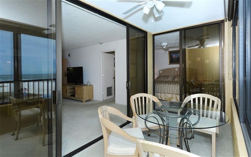 Lanai with sliders to Master and main living area - Condo for sale at 5790 Midnight Pass Rd #704, Sarasota, FL 34242 - MLS Number is A4208095