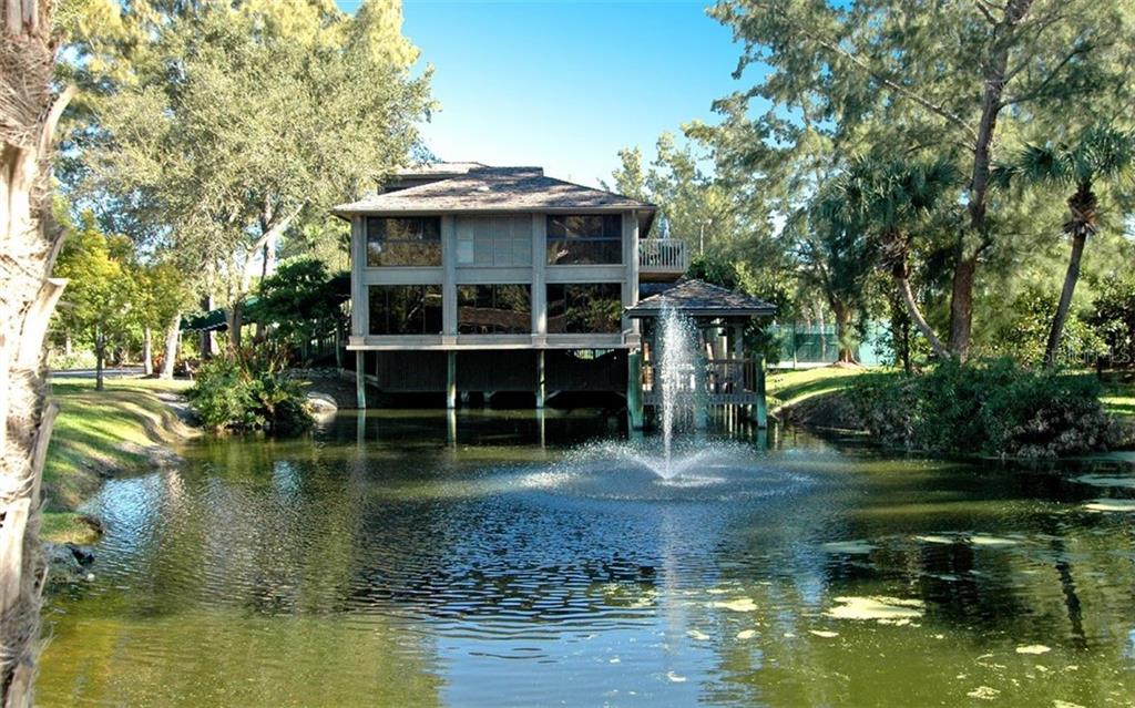Casarina Clubhouse with fountain and lake - Condo for sale at 5880 Midnight Pass Rd #810, Sarasota, FL 34242 - MLS Number is A4208619