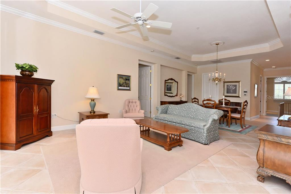 Living room/dining room interior view. - Condo for sale at 5242 Parisienne Pl #201bd30, Sarasota, FL 34238 - MLS Number is A4208770