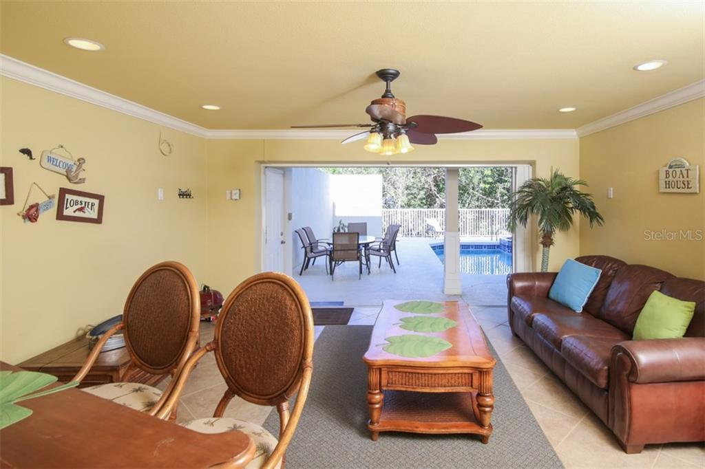 Game room / bar at pool level - Single Family Home for sale at 455 Canal Rd, Sarasota, FL 34242 - MLS Number is A4209817