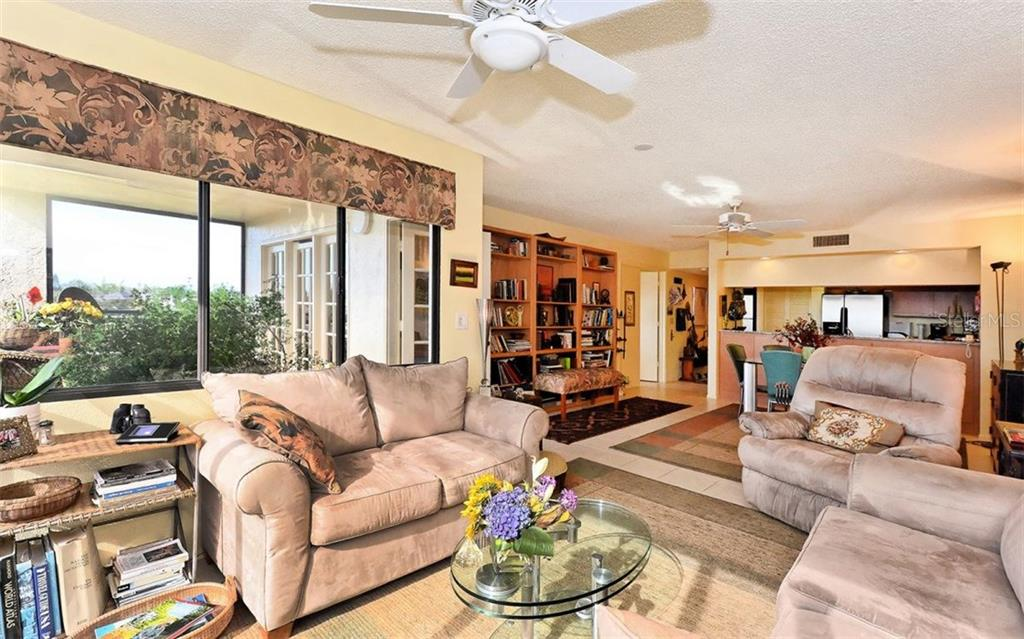 Living room to kitchen view. - Condo for sale at 835 S Osprey Ave #314, Sarasota, FL 34236 - MLS Number is A4210271