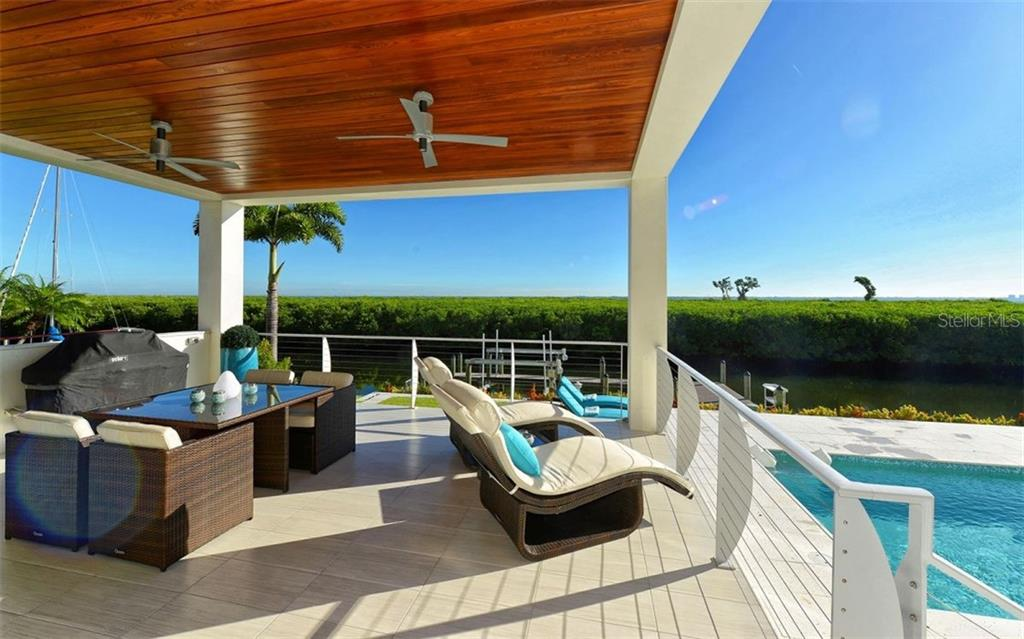 Single Family Home for sale at 1590 Harbor Cay Ln, Longboat Key, FL 34228 - MLS Number is A4210282