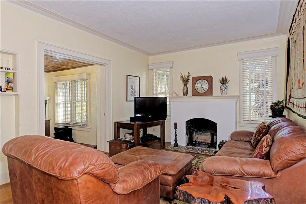 Living room with wood burning fireplace - Single Family Home for sale at 1874 Wisteria St, Sarasota, FL 34239 - MLS Number is A4211659