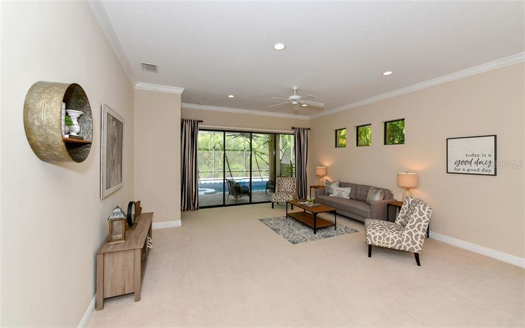 Living area with windows for natural light and view back to the foyer entry. Dining space just off the kitchen. - Single Family Home for sale at 7325 Wexford Ct, Lakewood Ranch, FL 34202 - MLS Number is A4212155