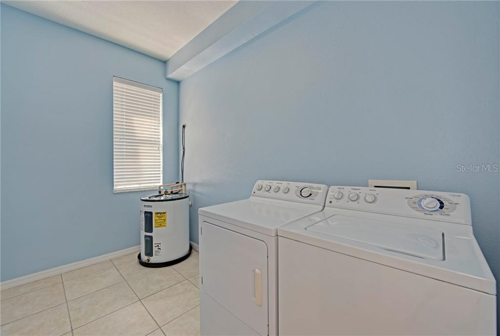 Inside utility room - Condo for sale at 5360 Mang Pl #1405, Sarasota, FL 34238 - MLS Number is A4212314