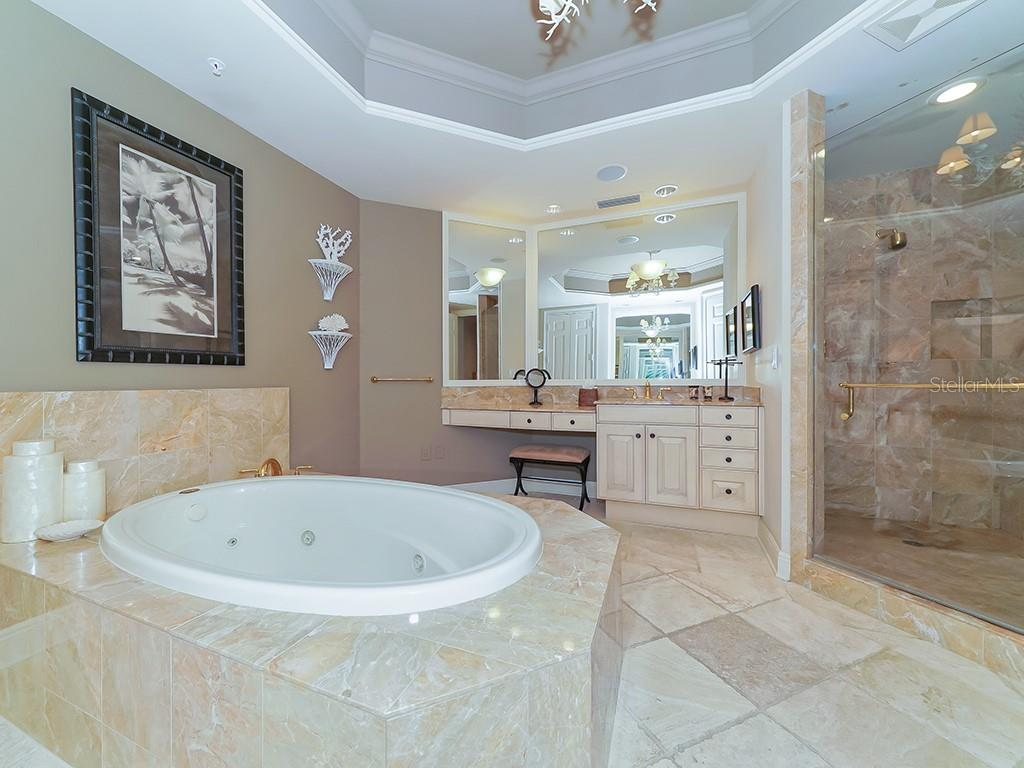 Master Bathroom - Soaking Tub and Large Walk-in Shower - Condo for sale at 1300 Benjamin Franklin Dr #603, Sarasota, FL 34236 - MLS Number is A4213631