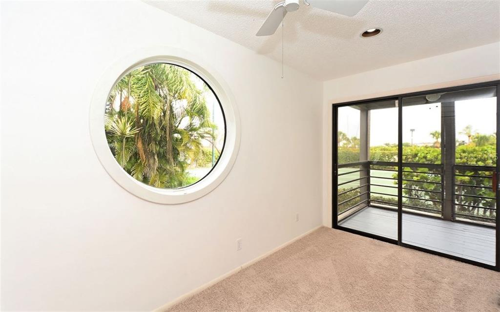 Den or third bedroom looking onto screened porch - Condo for sale at 3440 Gulf Of Mexico Dr #8, Longboat Key, FL 34228 - MLS Number is A4214047
