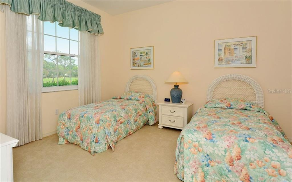 Bedroom 2 - Single Family Home for sale at 402 Trenwick Ln, Venice, FL 34293 - MLS Number is A4214615
