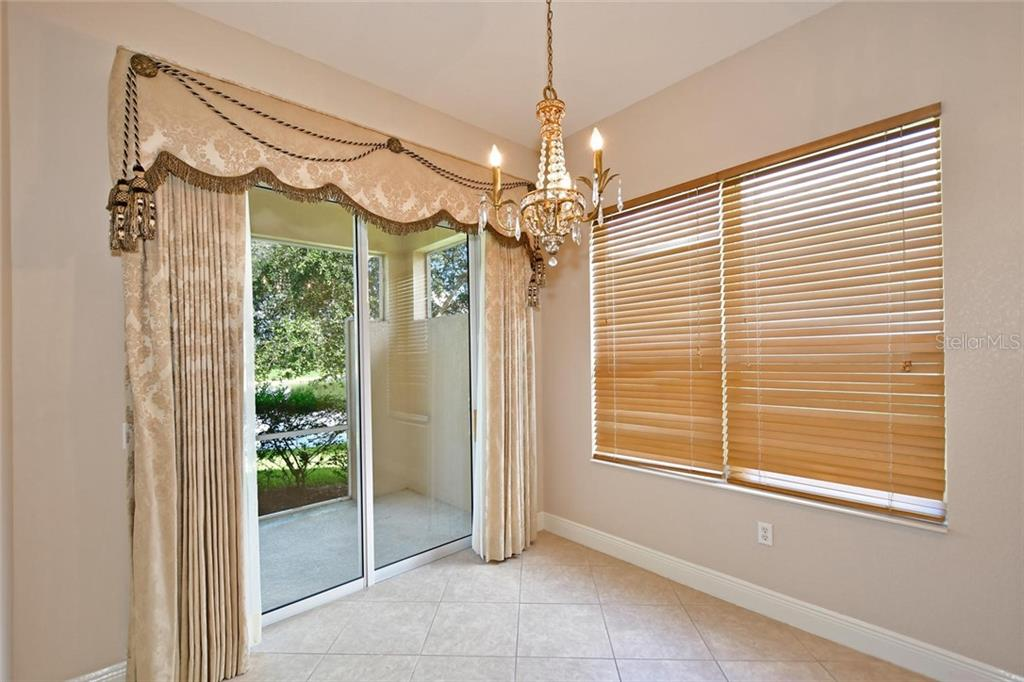 Separate Breakfast area with peaceful views of the lake. Custom window treatments and chandelier included. - Single Family Home for sale at 3729 Summerwind Cir, Bradenton, FL 34209 - MLS Number is A4215992