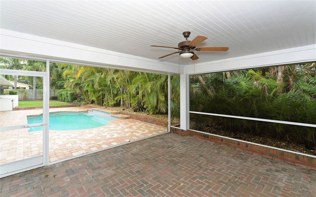 Screened gazebo overlooking the lush tropical foliage. - Single Family Home for sale at 1670 Bay View Dr, Sarasota, FL 34239 - MLS Number is A4400079