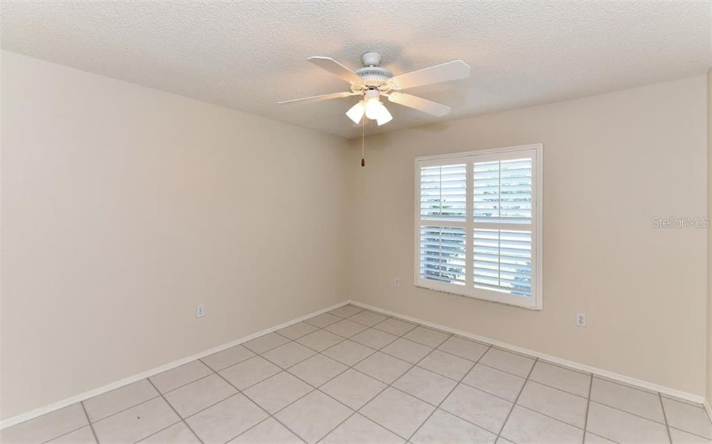 Front Bedroom Two with Plantation Shutters... - Single Family Home for sale at 6202 65th Ct E, Palmetto, FL 34221 - MLS Number is A4400567