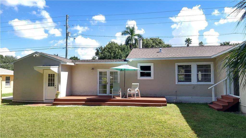 Backyard with deck - Single Family Home for sale at 1802 26th St W, Bradenton, FL 34205 - MLS Number is A4402735