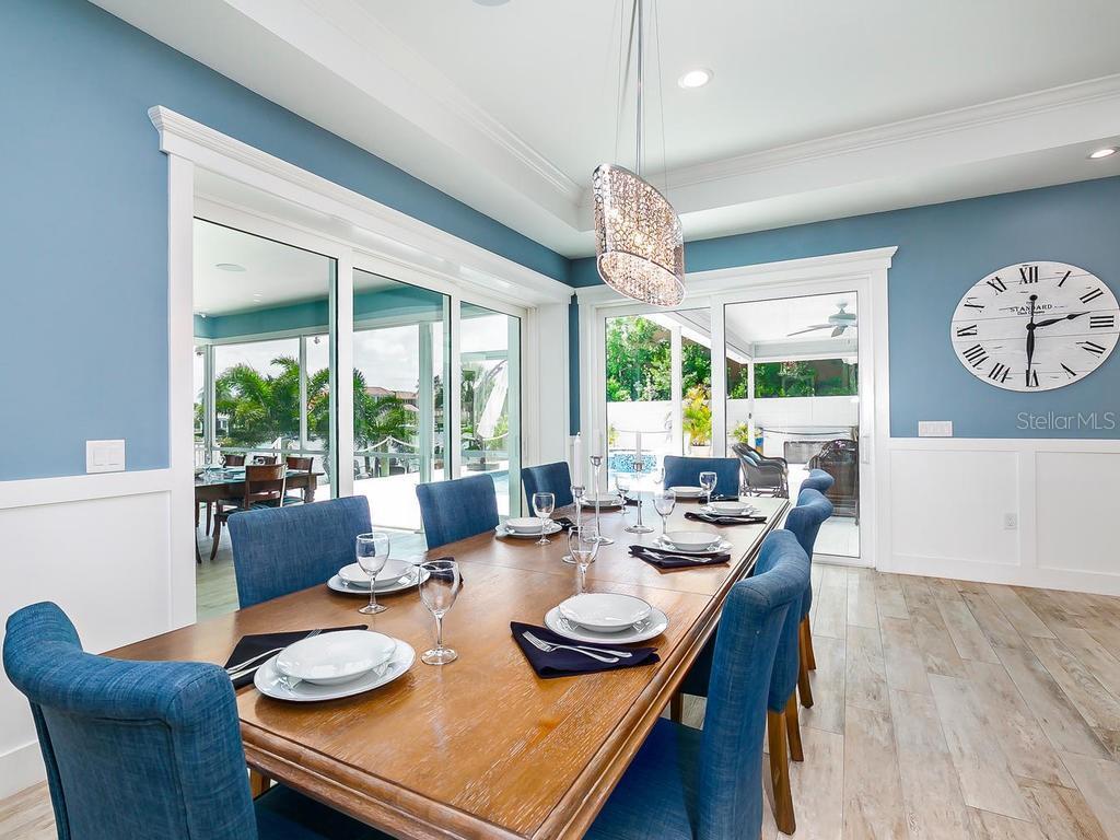 Dining area with views to outdoor - Single Family Home for sale at 7643 Cove Ter, Sarasota, FL 34231 - MLS Number is A4403215