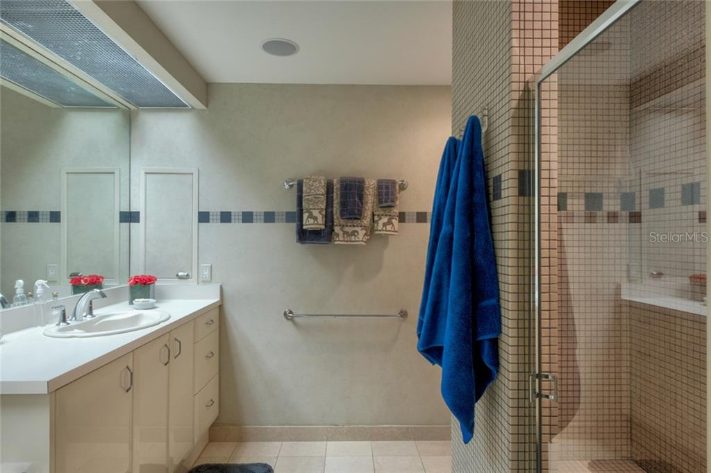 His bath suite - Condo for sale at 340 S Palm Ave #412, Sarasota, FL 34236 - MLS Number is A4403968