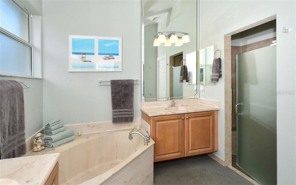 Master Bathroom - Single Family Home for sale at 6507 42nd St E, Sarasota, FL 34243 - MLS Number is A4404611
