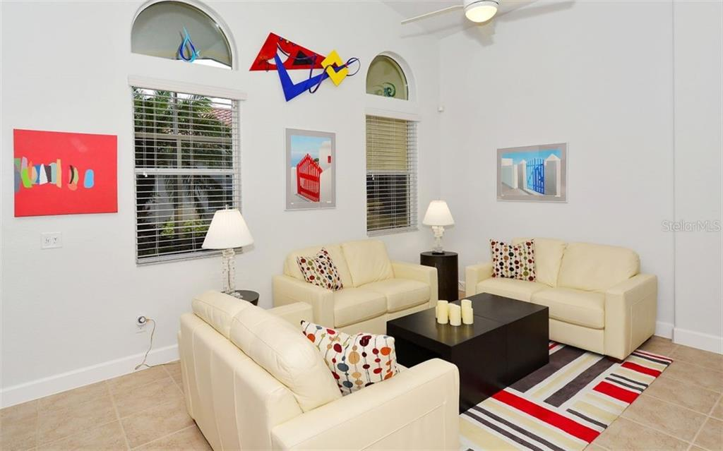 Living room area - Single Family Home for sale at 6507 42nd St E, Sarasota, FL 34243 - MLS Number is A4404611