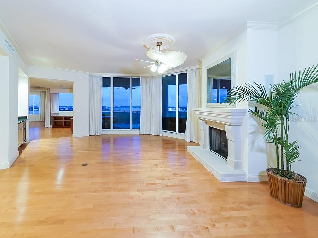 Grand Salon with Gas Fireplace - Condo for sale at 1300 Benjamin Franklin Dr #1008, Sarasota, FL 34236 - MLS Number is A4405360
