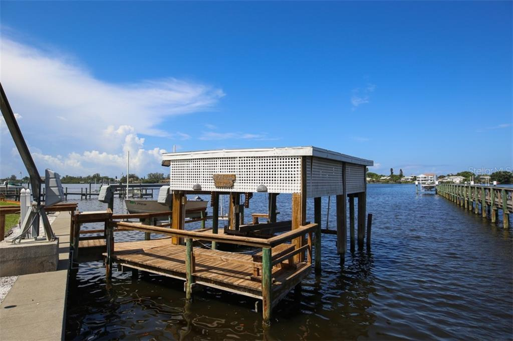 Grandfathered Boat House, 2 Electric Lifts and Davit - Single Family Home for sale at 1778 Bayshore Dr, Englewood, FL 34223 - MLS Number is A4405962