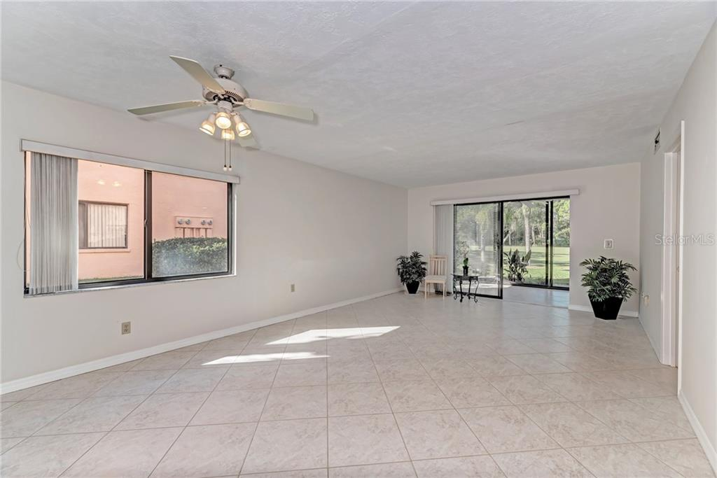 Enclosed lanai - Condo for sale at 7670 Eagle Creek Dr, Sarasota, FL 34243 - MLS Number is A4406667