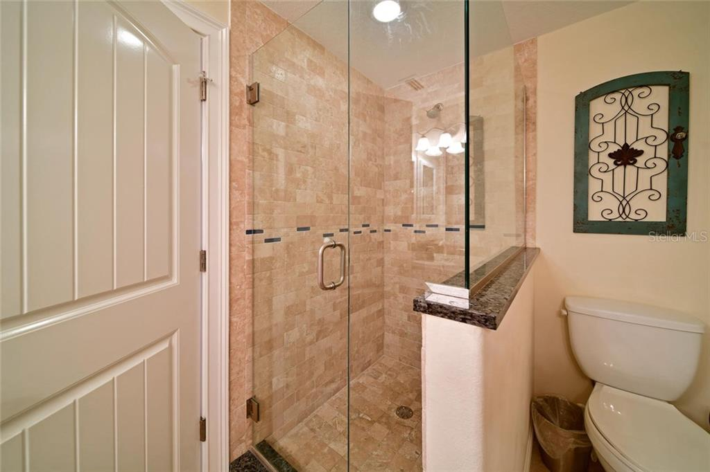 This elegant glass shower is the highlight of the bath room in the large upstairs bathroom. - Single Family Home for sale at 113 36th St, Holmes Beach, FL 34217 - MLS Number is A4407267