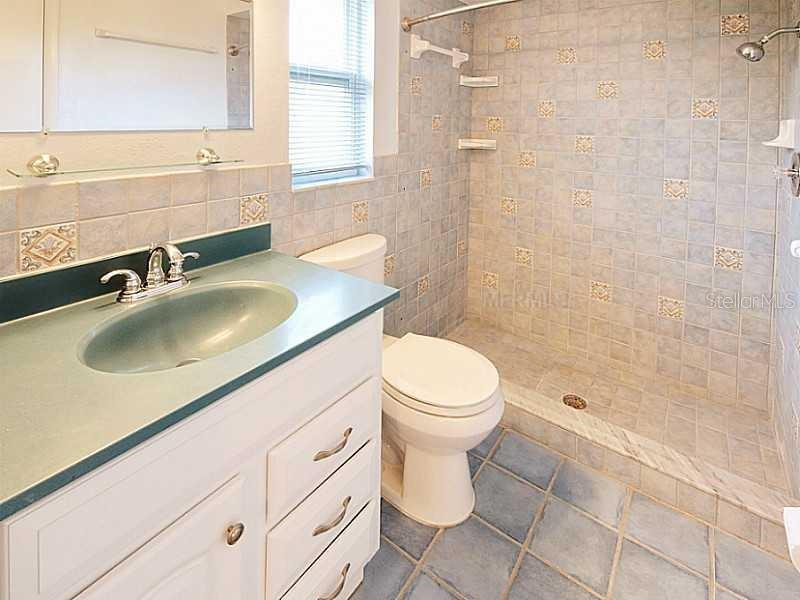 master bath (sink has been changed to cream colored Corian - Single Family Home for sale at 7208 Pointe West Blvd, Bradenton, FL 34209 - MLS Number is A4407642