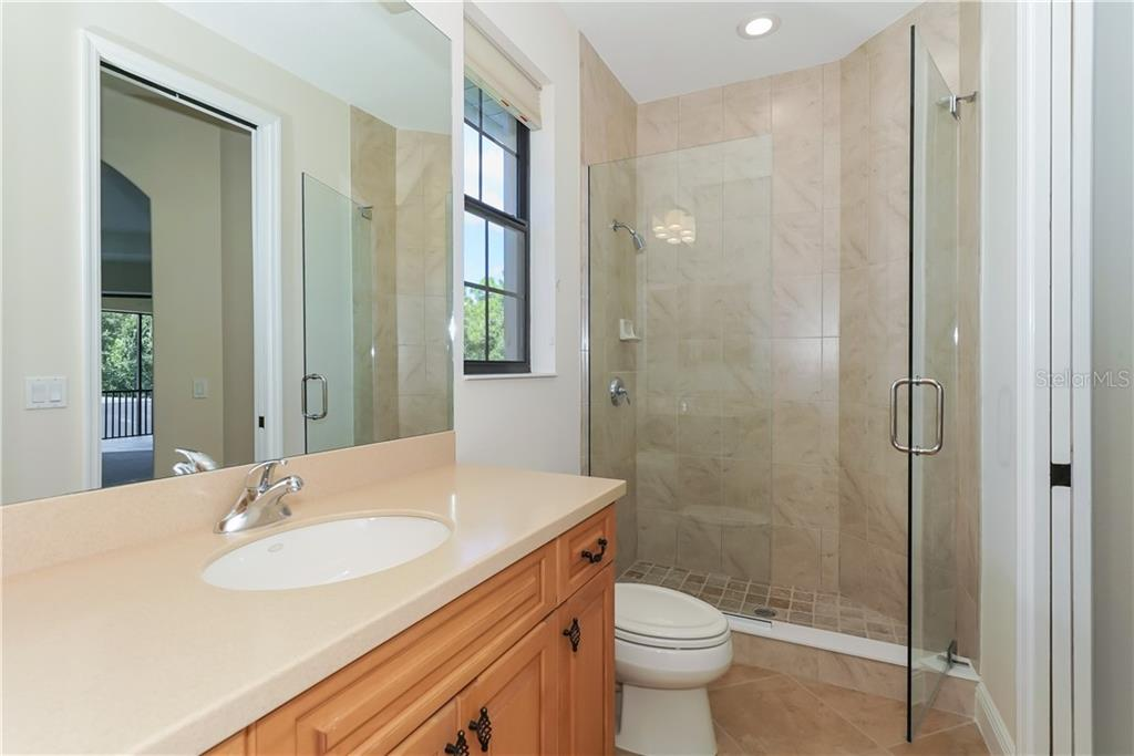 New lighting and frameless glass shower doors installed in guest bathrooms - Single Family Home for sale at 13219 Palmers Creek Ter, Lakewood Ranch, FL 34202 - MLS Number is A4407857