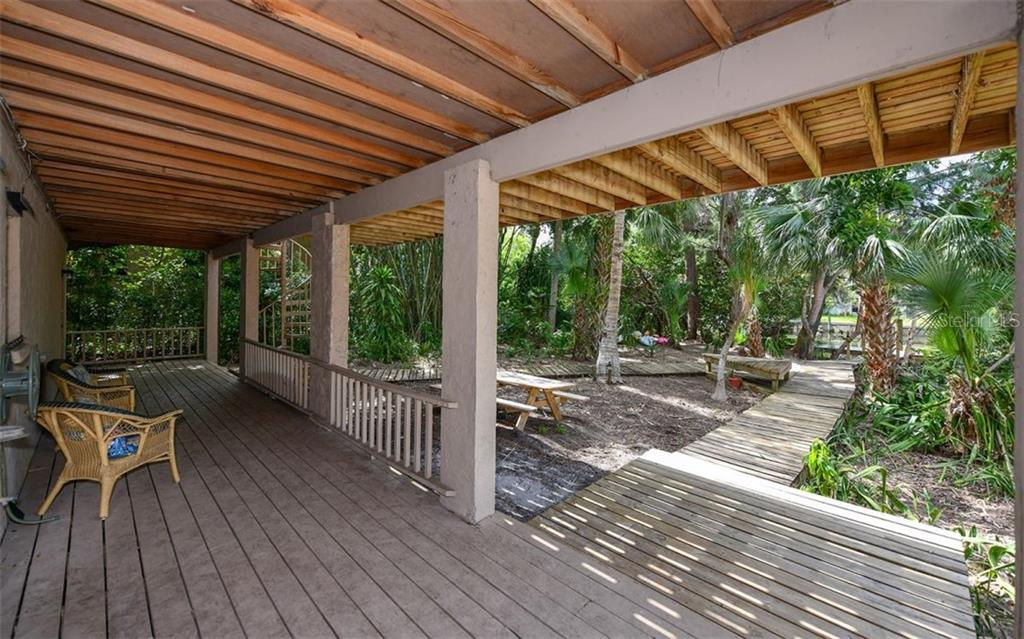 Covered Back Porch - Single Family Home for sale at 1238 Sea Plume Way, Sarasota, FL 34242 - MLS Number is A4408272