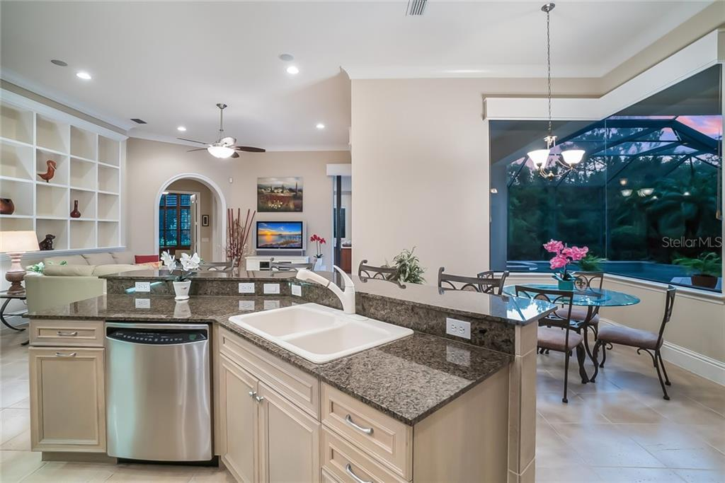 Kitchen and Dinette with views of the pool and preserve. - Single Family Home for sale at 13223 Palmers Creek Ter, Lakewood Ranch, FL 34202 - MLS Number is A4408290