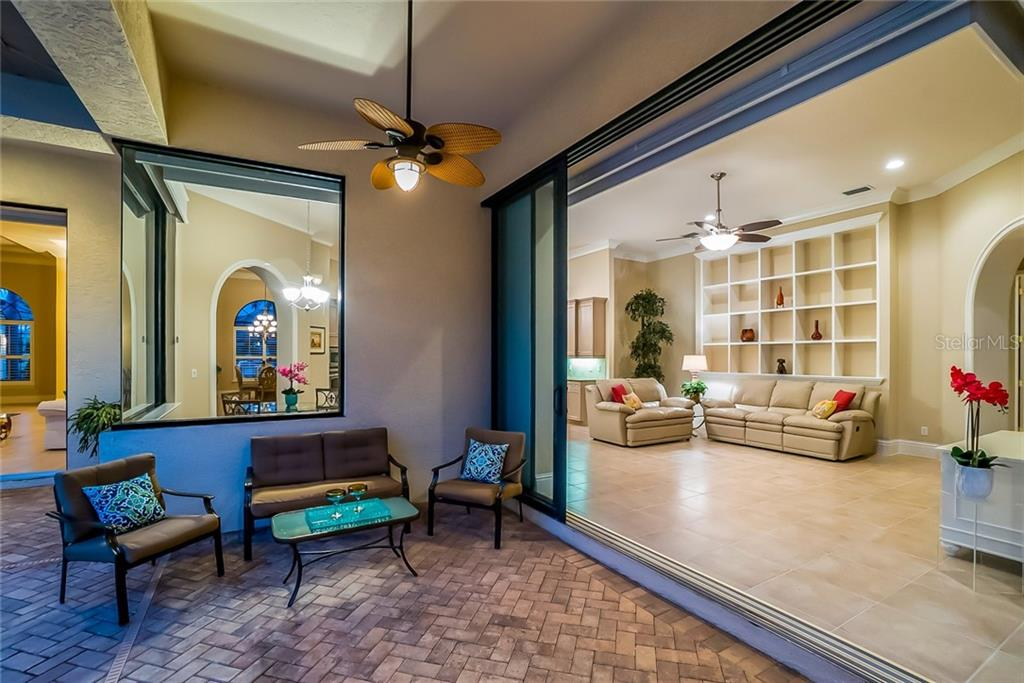 Additional covered patio - great for lounging - large pocket sliders lead to the family room. - Single Family Home for sale at 13223 Palmers Creek Ter, Lakewood Ranch, FL 34202 - MLS Number is A4408290