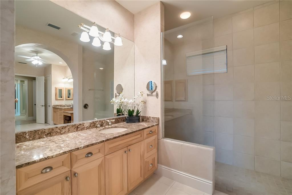 Master Bath: a additional counter with sink and large walk-in shower. - Single Family Home for sale at 13223 Palmers Creek Ter, Lakewood Ranch, FL 34202 - MLS Number is A4408290
