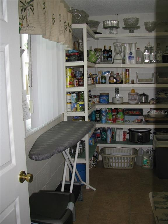 More storage in the large pantry/laundry room - Single Family Home for sale at 1911 29th St W, Bradenton, FL 34205 - MLS Number is A4409585