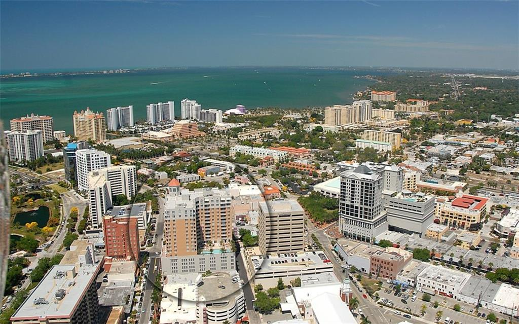 This aerial view shows you how close you are to the bay - just 2 blocks from the entrance the Marina Jack's - Condo for sale at 1350 Main St #1007, Sarasota, FL 34236 - MLS Number is A4410487