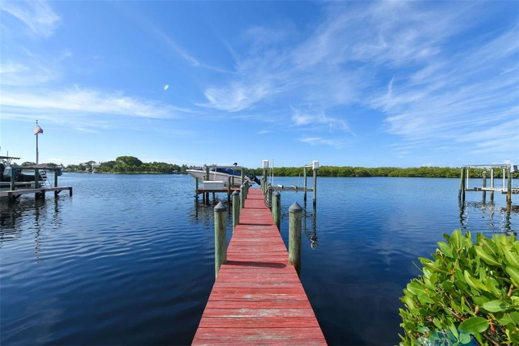 Wonderful boating, fishing and views. There are two 10,000 lb. lifts. Minutes to Gulf access. - Single Family Home for sale at 417 Bayview Pkwy, Nokomis, FL 34275 - MLS Number is A4411087