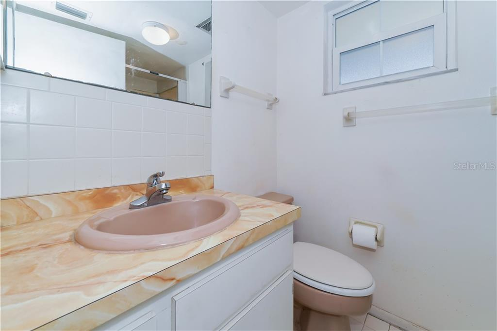 Master bathroom with shower/tub - Single Family Home for sale at 5591 Cape Aqua Dr, Sarasota, FL 34242 - MLS Number is A4411099
