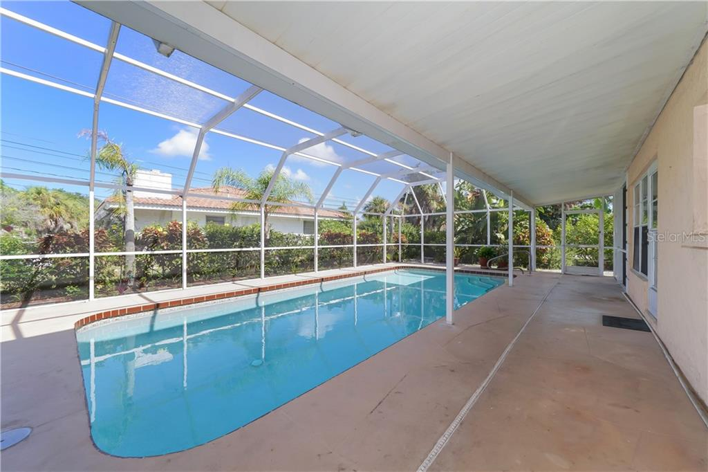 Endless possibilities for bonus room off of swimming pool - Single Family Home for sale at 5591 Cape Aqua Dr, Sarasota, FL 34242 - MLS Number is A4411099