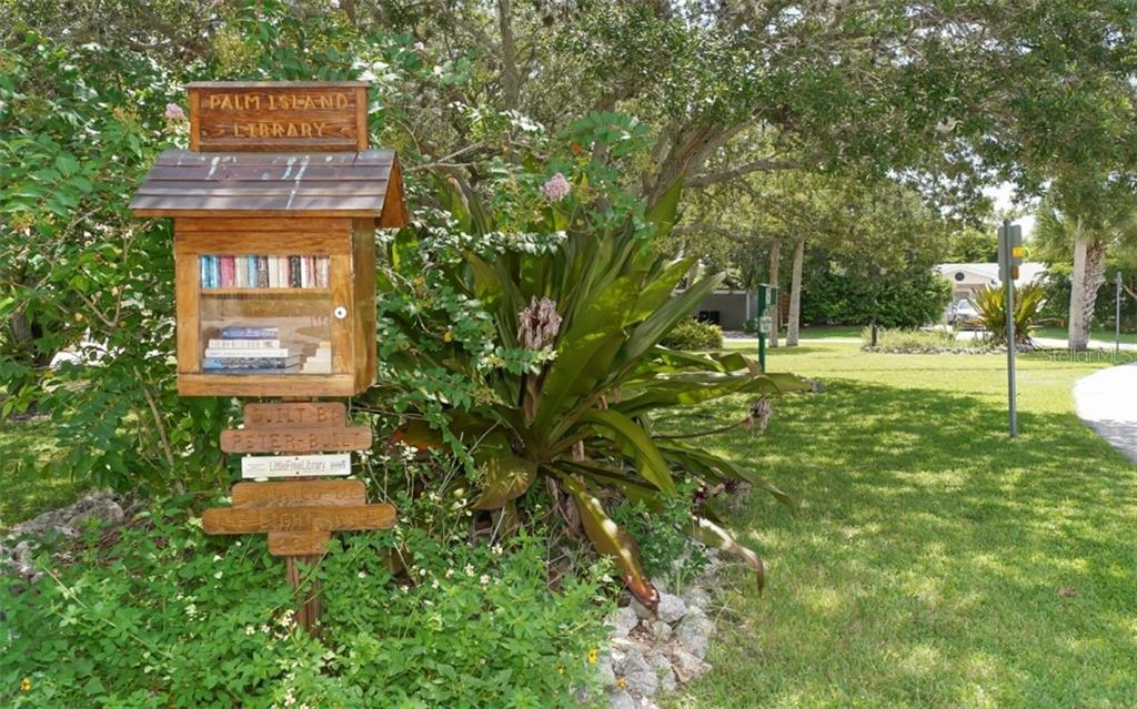 Elsie Blair park is just outside your front door features a give and take library. - Single Family Home for sale at 138 Island Cir, Sarasota, FL 34242 - MLS Number is A4412265