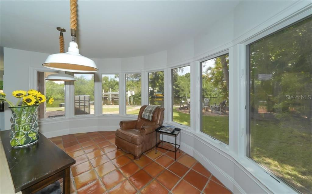 Your tranquil view of the water from the formal dining area - Single Family Home for sale at 138 Island Cir, Sarasota, FL 34242 - MLS Number is A4412265