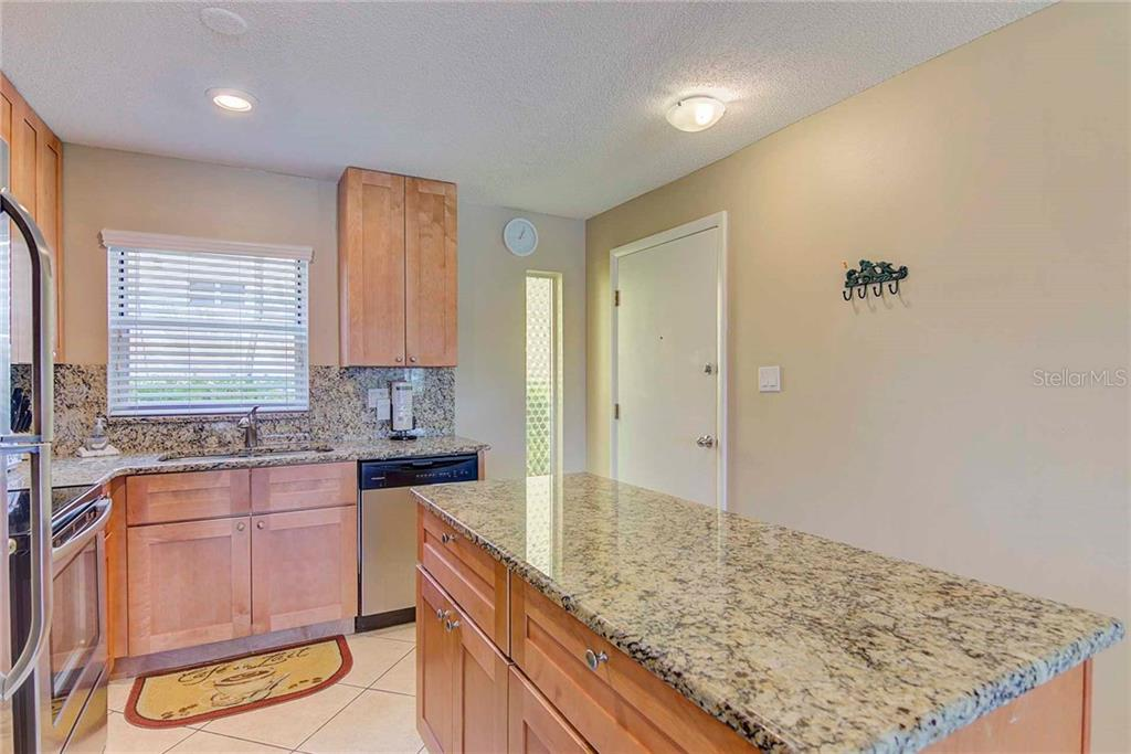 New Kitchen Cabinets, Granite and Appliances - Condo for sale at 925 Beach Rd #107b, Sarasota, FL 34242 - MLS Number is A4413716